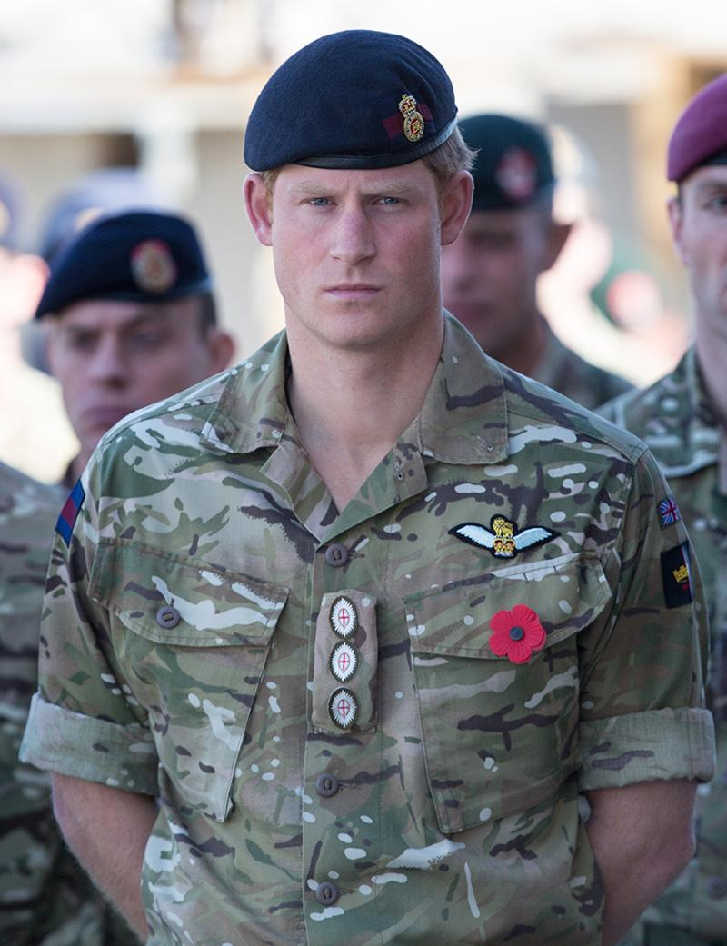 A remembrance poppy adorns the uniform of Prince Harry as he joins British troops and service personal remaining in Afghanistan