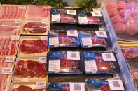 Beef products from New Zealand with a QR-code linked to its coronavirus test results are displayed at a supermarket in Beijing, Tuesday, Nov. 24, 2020. China has stirred controversy with claims it has detected the coronavirus on packages of imported frozen food. (AP Photo/Ng Han Guan)