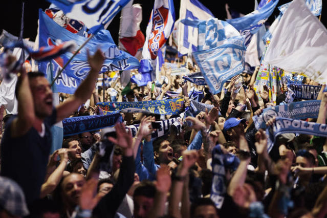 Napoli's football fans celebrate the victory of their team in Naples on May 20, 2012. S.S.C. Juventus' record-breaking 43-match undefeated run came to an end when Napoli won the Italian Cup 2-0. AFP PHOTO/ ANDREA BALDOANDREA BALDO/AFP/GettyImages