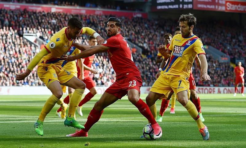Liverpool's Emre Can competes with Joel Ward and Yohan Cabaye of Crystal Palace during the Premier League match.