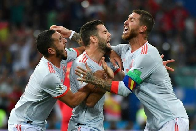 Spain celebrate a goal in their opening World Cup match against Portugal