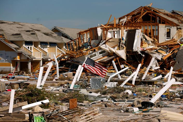 <p>An American flag flies amongst rubble left in the aftermath of Hurricane Michael in Mexico Beach, Fla., Oct. 11, 2018. (Photo: Jonathan Bachman/REUTERS) </p>