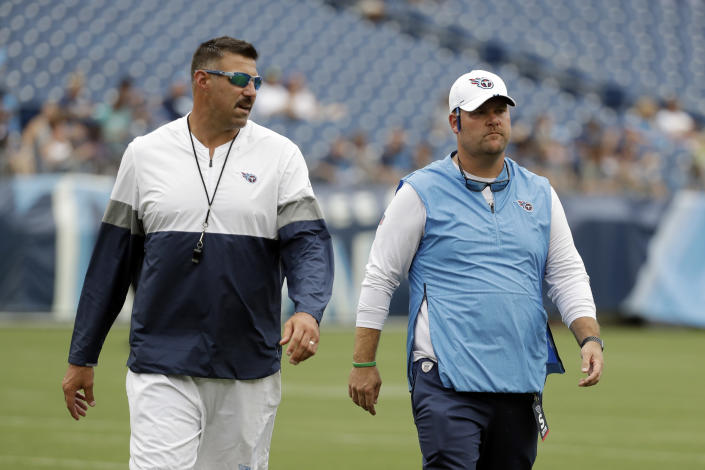 FILE — In this Aug. 3, 2019, file photo, Tennessee Titans head coach Mike Vrabel, left, and general manager Jon Robinson walk on the field before a practice during NFL football training camp in Nashville, Tenn. The Titans have been picking themselves apart since the season ended. They won the AFC South and hosted a playoff game for the first time since 2008, but they lost on their own field, well short of the AFC championship game of a year before. (AP Photo/Mark Humphrey, File)