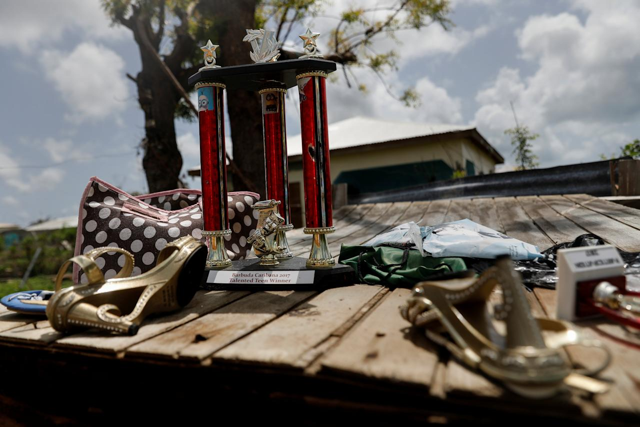 <p>A trophy and other items are seen on the remains of a home at Codrington on the island of Barbuda just after a month after Hurricane Irma struck the Caribbean islands of Antigua and Barbuda, October 7, 2017. REUTERS/Shannon Stapleton </p>