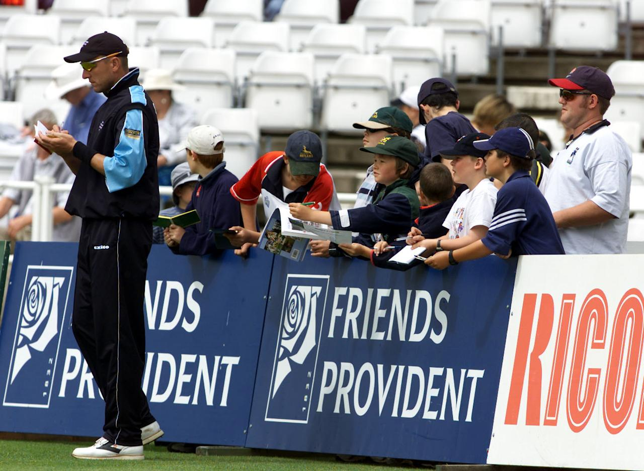 30 Jun 2001:  Allan Donald of the Sir Richard Hadlee XI signs autographs during the the one day match between the Sir Richard Hadlee XI and the Sir Garfield Sobers XI at Trent Bridge in Nottingham . Digital Image. Mandatory Credit: Laurence Griffiths/ALLSPORT