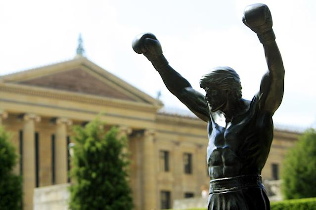 "The bronze statue of Sylvester Stallone portraying the boxer from the film ""Rocky III"" is seen shortly after workers installed it near the steps of the Philadelphia Museum of Art in Philadelphia. (AP Photo/Matt Rourke)"