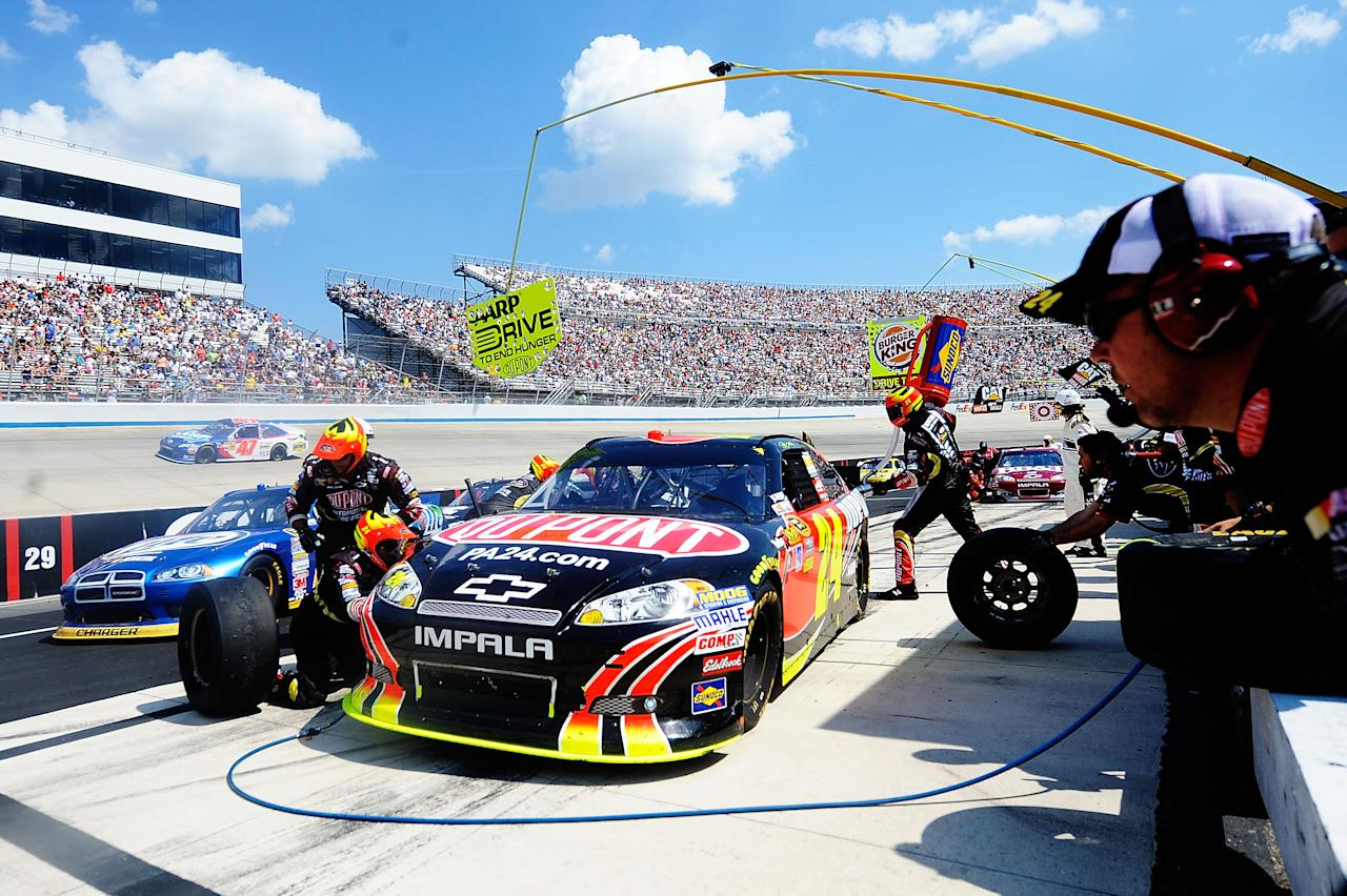 DOVER, DE - JUNE 03:  Jeff Gordon, driver of the #24 DuPont Chevrolet, pits during the NASCAR Sprint Cup Series FedEx 400 benefiting Autism Speaks at Dover International Speedway on June 3, 2012 in Dover, Delaware.  (Photo by Patrick McDermott/Getty Images for NASCAR)