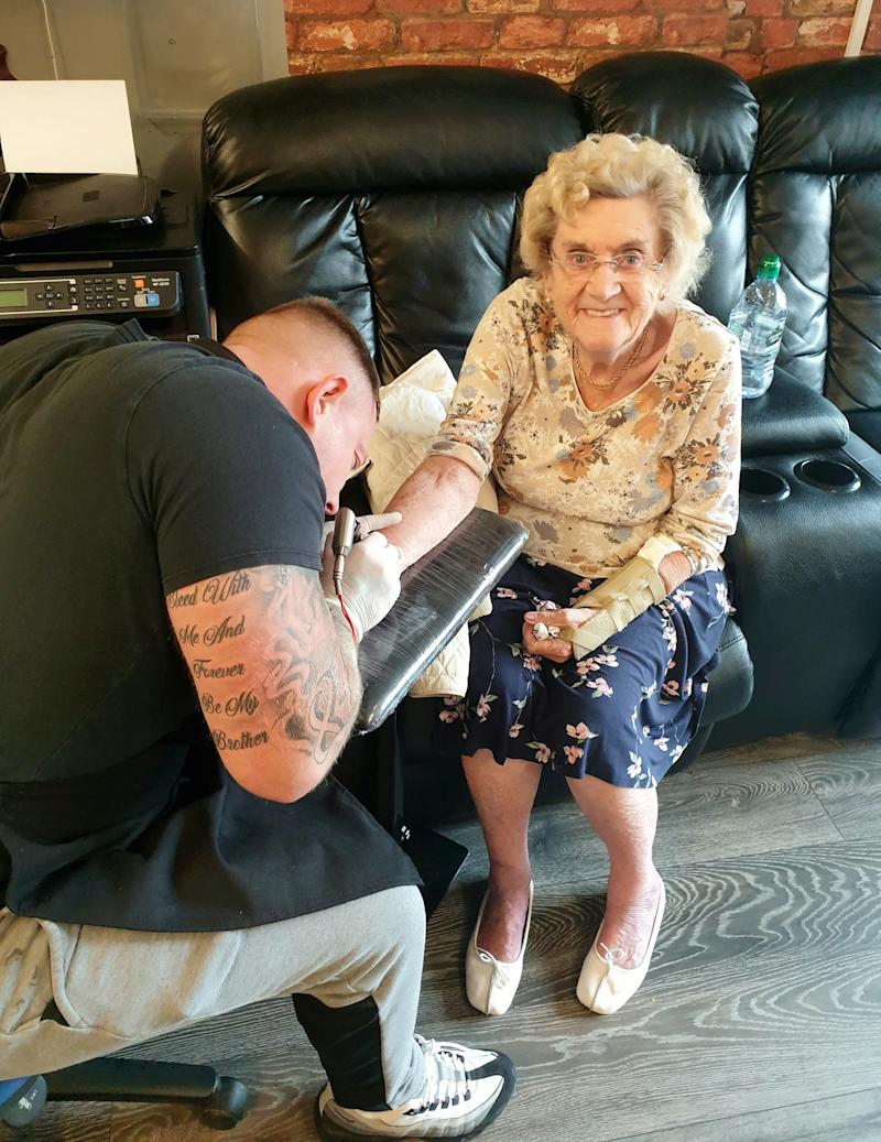 Hilda West having a tattoo done by tattoo artist Matty Gardner (Picture: SWNS)