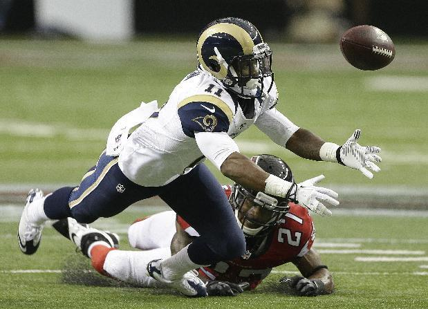 St. Louis Rams wide receiver Tavon Austin (11) vies for a thrown ball against Atlanta Falcons cornerback Robert McClain (27) during the first half of an NFL football game, Sunday, Sept. 15, 2013, in Atlanta. (AP Photo/John Bazemore)
