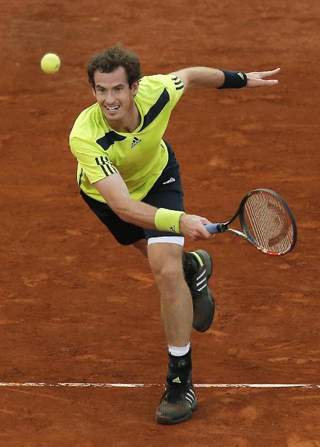 Andy Murray returns the ball during a Madrid Open tennis tournament match against Nicolas Almagro from Spain, in Madrid, Spain, Wednesday, May 7, 2014. (AP Photo/Andres Kudacki)
