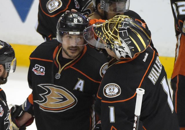 Anaheim Ducks right wing Teemu Selanne, of Finland,, left, gets a pat on the head from goalie Jonas Hiller, of Switzerland, after Game 7 of an NHL hockey second-round Stanley Cup playoff series against the Los Angeles Kings, Friday, May 16, 2014, in Anaheim, Calif. The Kings won 6-2. (AP Photo/Mark J. Terrill)
