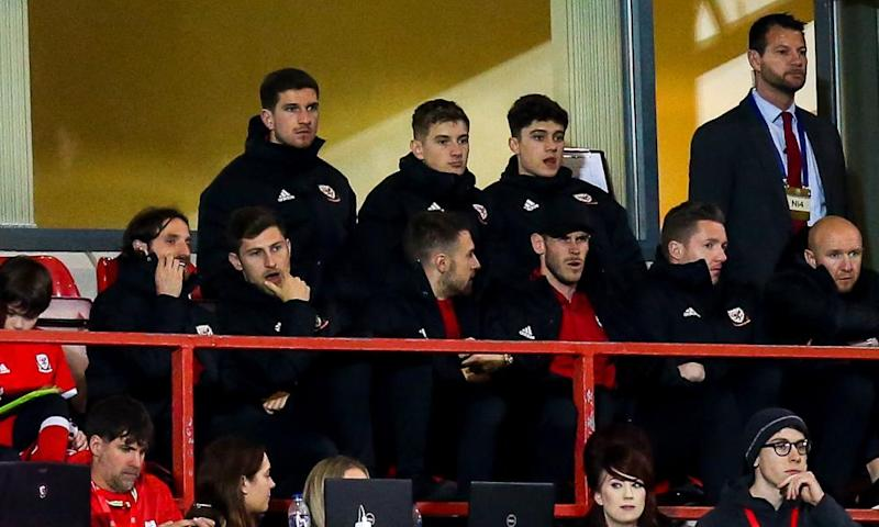 Gareth Bale sits in the stands with Joe Allen, Ben Davies, Aaron Ramsey, Wayne Hennessey and other members of the Wales squad.