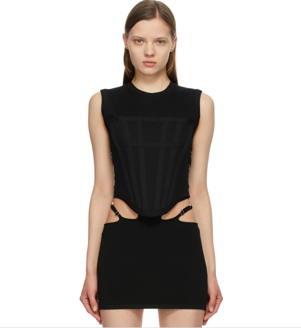 model wearing black cut out Dion Lee top and skirt