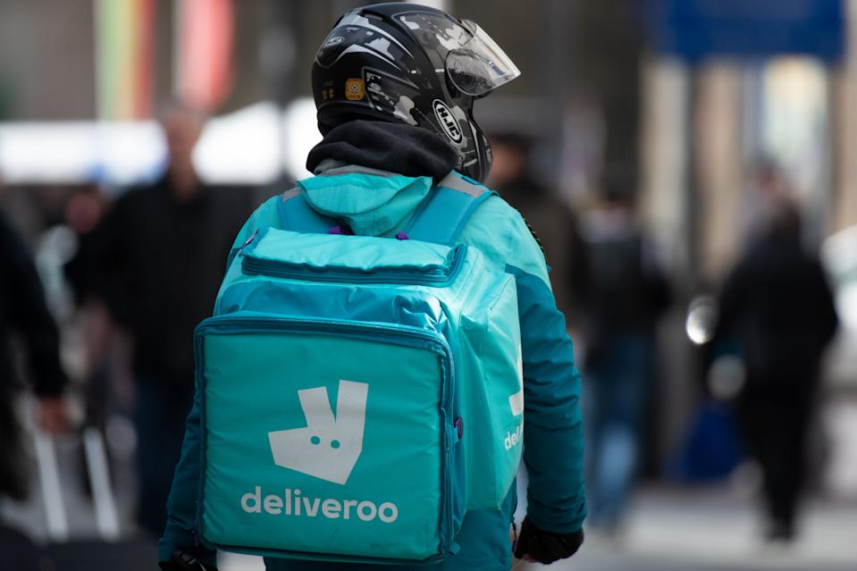 CARDIFF, UNITED KINGDOM - MARCH 13: A Deliveroo worker on March 13, 2020 in Cardiff, United Kingdom. Food delivery services have reported a surge in sales as consumers opt to stay in during the coronavirus pandemic in the UK. (Photo by Matthew Horwood/Getty Images)
