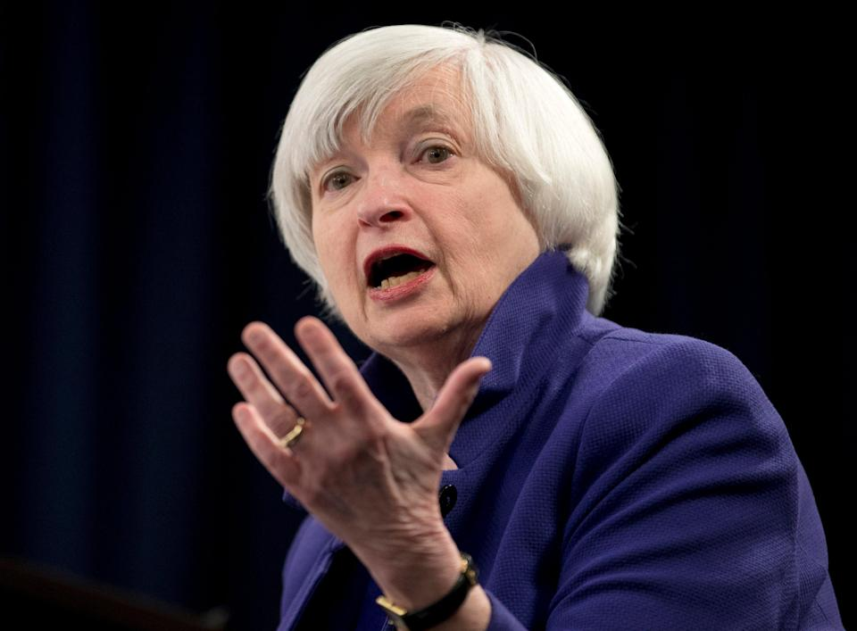 """FILE - In this Dec. 13, 2017 file photo, Federal Reserve Chair Janet Yellen speaks during a news conference following the Federal Open Market Committee meeting in Washington. Yellen, the first woman to head the Federal Reserve and the U.S. Treasury Department, says women seeking to pursue careers in economics face a number of obstacles from the way beginning economics courses are taught to overly aggressive questioning questions in college seminars. """"There is a cultural problem in the profession and we need to change the culture,"""" Yellen said Monday, March 8, 2021. (AP Photo/Carolyn Kaster, File)"""
