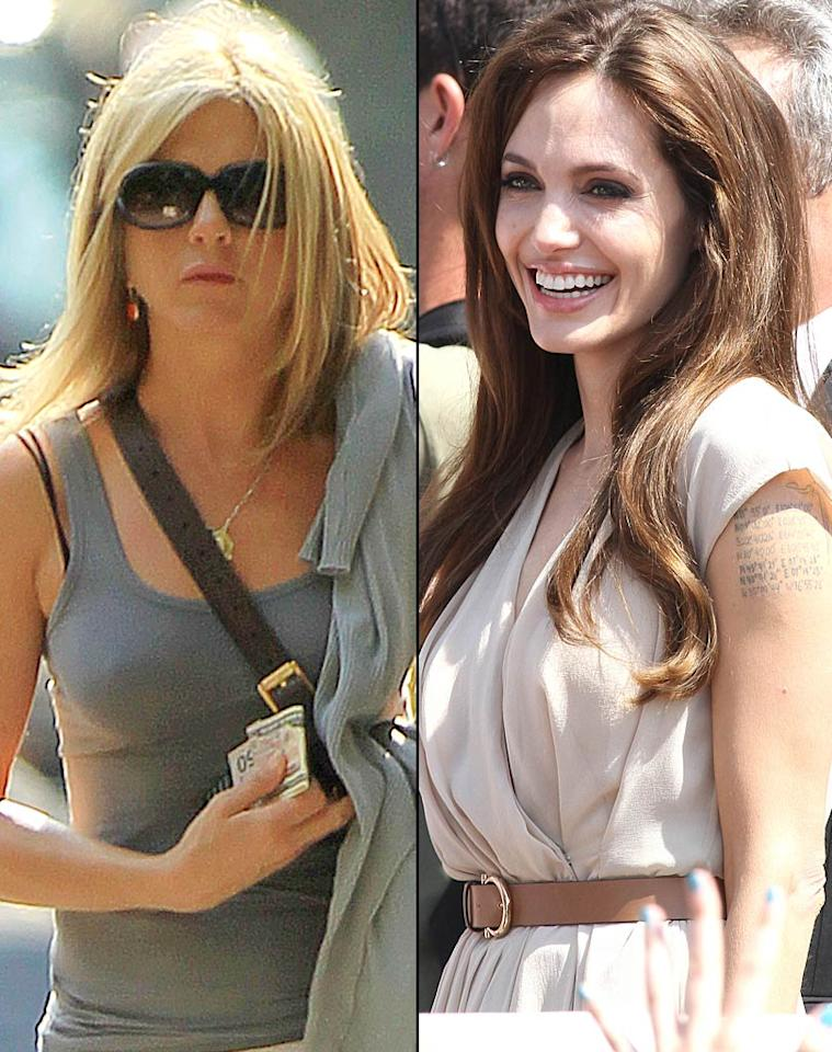 """According to <i>Life & Style</i>, Angelina Jolie -- for years cast as the villain in the Brad Pitt and Jennifer Aniston split -- is now spreading the rumor that Aniston is a """"home wrecker"""" who pried Justin Theroux away from his longtime girlfriend, Heidi Bivens. The mag says Jolie has been """"calling mutual Hollywood pals"""" and mockingly asking them, """"Who's the home wrecker now?"""" For how vicious it's getting between Jolie and Aniston, click over to <a href=""""http://www.gossipcop.com/heidi-bivens-jennifer-aniston-home-wrecker-stole-justin-theroux-angelina-jolie-rumors/"""" target=""""new"""">Gossip Cop</a>. KCSPresse/Jackson Lee/<a href=""""http://www.splashnewsonline.com"""" target=""""new"""">Splash News</a>, Ahmad Elatab/<a href=""""http://www.splashnewsonline.com"""" target=""""new"""">Splash News</a>"""