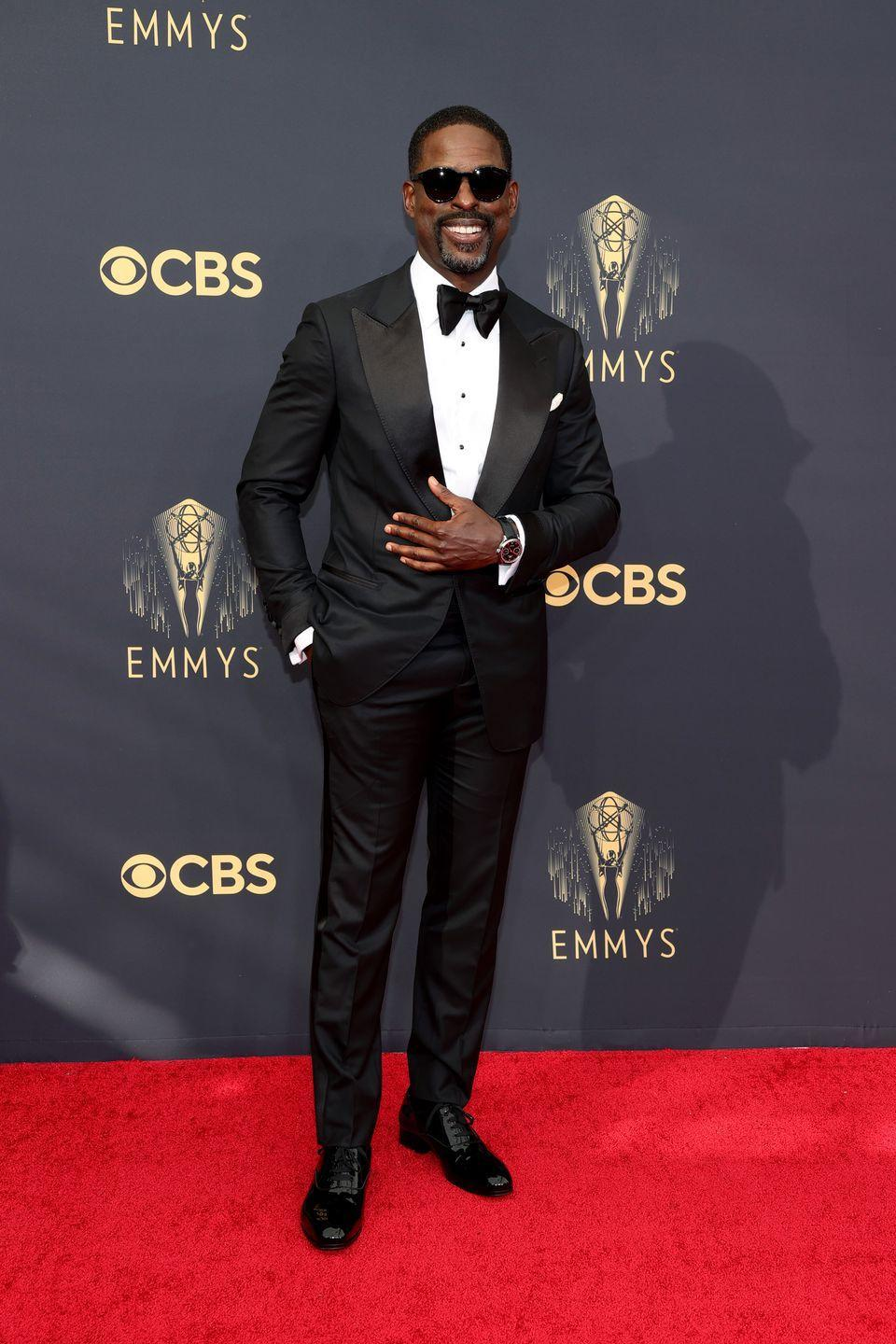 <p>The tuxedo is spot-on, but two key accessories—the sunglasses and the smile—take it over the top.</p><p><em>In Tom Ford and an IWC watch</em></p>