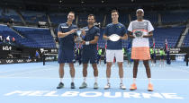 Slovakia's Filip Polasek, left, and Croatia's Ivan Dodig, second left, pose with their trophy after defeating Rajeev Ram, right, of the US and Britain's Joe Salisbury in the men's doubles final at the Australian Open tennis championship in Melbourne, Australia, Sunday, Feb. 21, 2021.(AP Photo/Andy Brownbill)