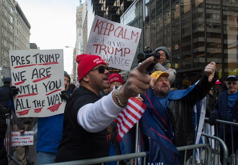 Supporters of US President Donald Trump yell at anti-Trump protesters at a rally near Trump Tower in Fifth Avenue, February 5, 2017 in New York