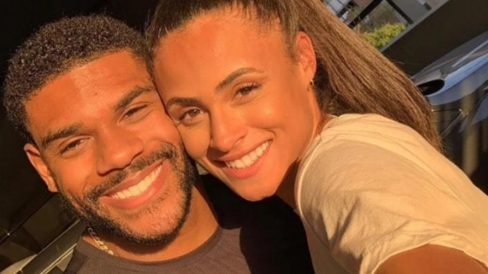Olympic gold medalist Sydney McLaughlin (right) recently got engaged to former NFL player Andre Levrone Jr. (left), she announced on social media. (Instagram)