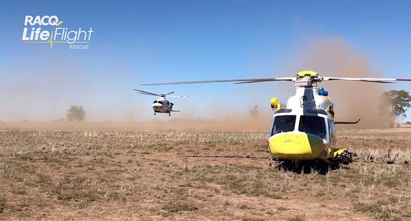 Two RACQ LifeFlight Rescue choppers arrived the farm, in the Western Downs region, Thursday morning. Source: RACQ LifeFlight Rescue
