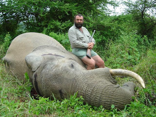 """Trophy hunting """"can benefit the conservation of certain species,"""" according to the U.S. Fish and Wildlife Service statement. Here, trophy hunter David Barrett with one of his kills in 2009 in Zimbabwe."""