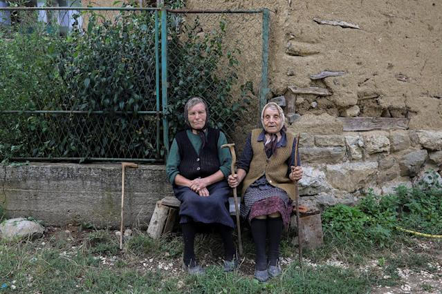 <p>Two elderly women sit in front of their home in the village of Gornja Kamenica, near the southeastern town of Knjazevac, Serbia, Aug. 14, 2017. (Photo: Marko Djurica/Reuters) </p>