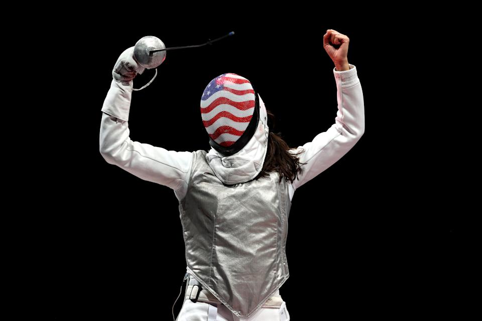 Lee Kiefer celebrates the first individual foil Olympic gold medal in American history. (Elsa/Getty Images)