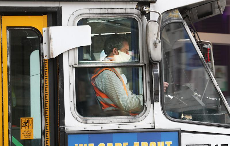 A tram driver is seen wearing a mask in Swanston street in Melbourne, Sunday, July 19, 2020.