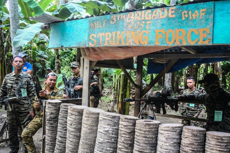 Rebel fighters in the Philippines are handing in their weapons, in a process aimed at turning the Moro Islamic Liberation Front into a regular political party