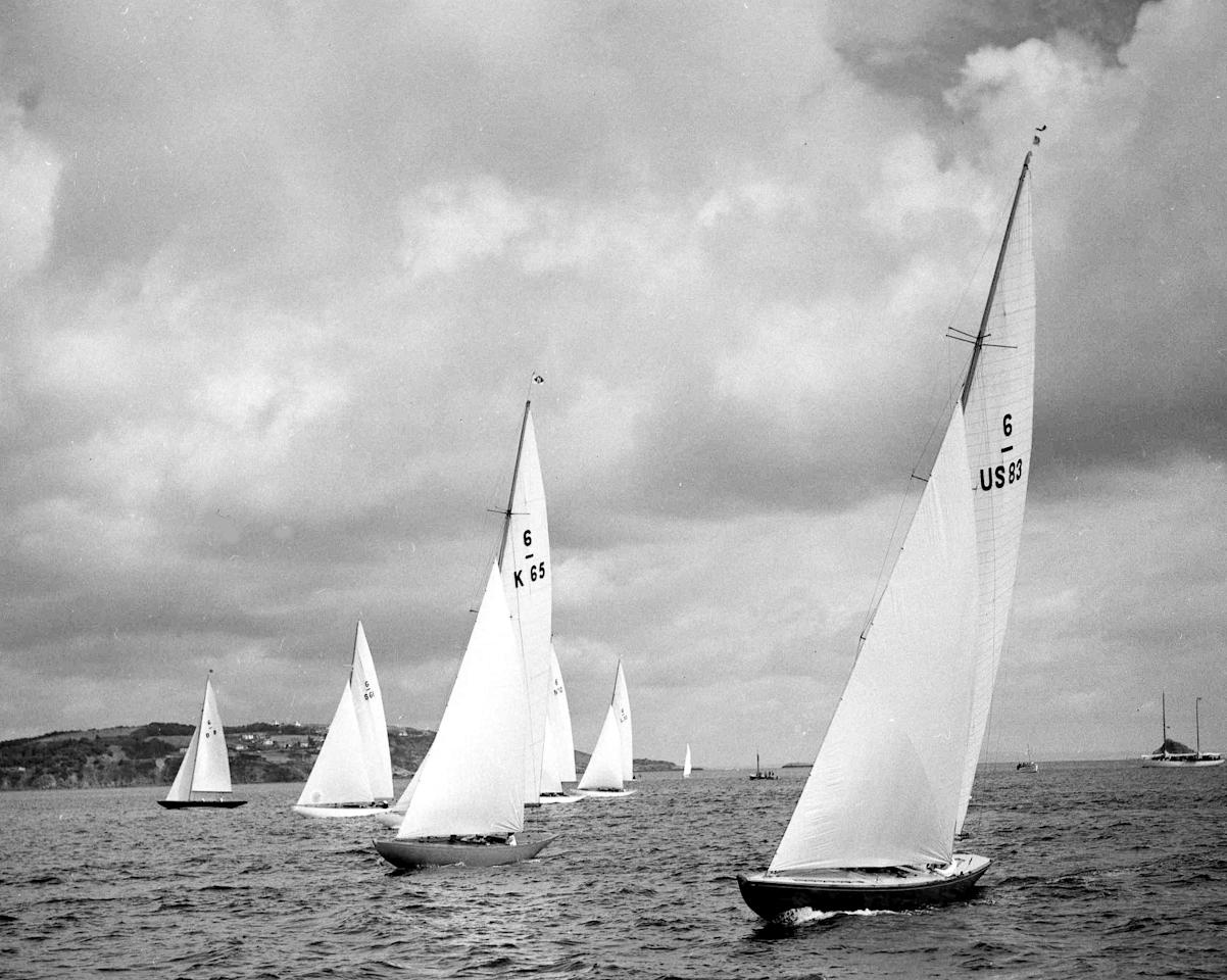 "America's ""Llanoria"", right, and Britain's ""Johan"", second right, at the start of the Olympic Games 6-metre yacht race, at Torbay, England, Aug. 3, 1948. (AP Photo)"