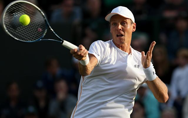 Tomas Berdych during a Wimbledon match in London on June 27, 2014 (AFP Photo/Andrew Cowie)