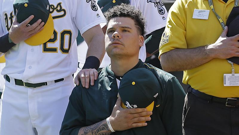 A's catcher Bruce Maxwell says he'll stand for the national anthem this year. (AP)