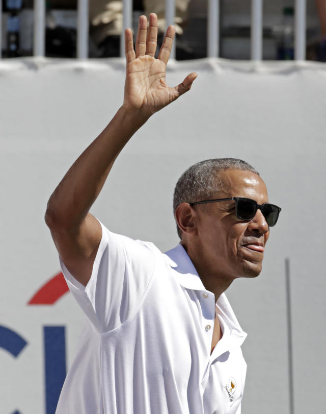 <p>Former President Barack Obama waves to spectators before the first round of the Presidents Cup at Liberty National Golf Club in Jersey City, N.J., Thursday, Sept. 28, 2017. (AP Photo/Julio Cortez) </p>