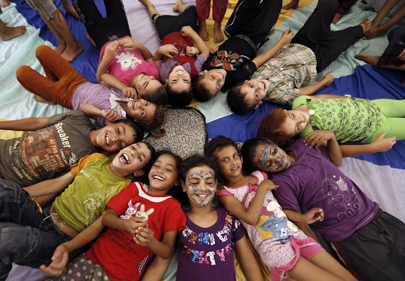 Palestinian children affected by the war attend a group class at a school in Jabalia as part of the United Nations community mental health programmes in the Gaza Strip, on August 2, 2014