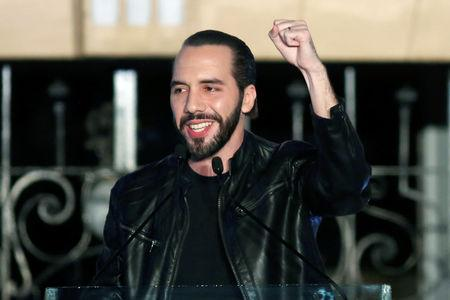 Presidential candidate Nayib Bukele of the Great National Alliance (GANA) gestures to his supporters after official results in downtown San Salvador