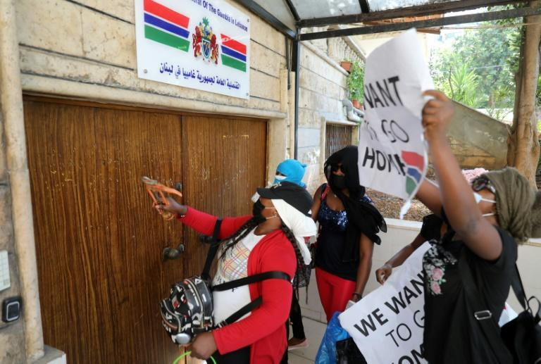 Protestors hammer the doors of The Gambia's consulate in Beirut demanding to be evacuated back to their country