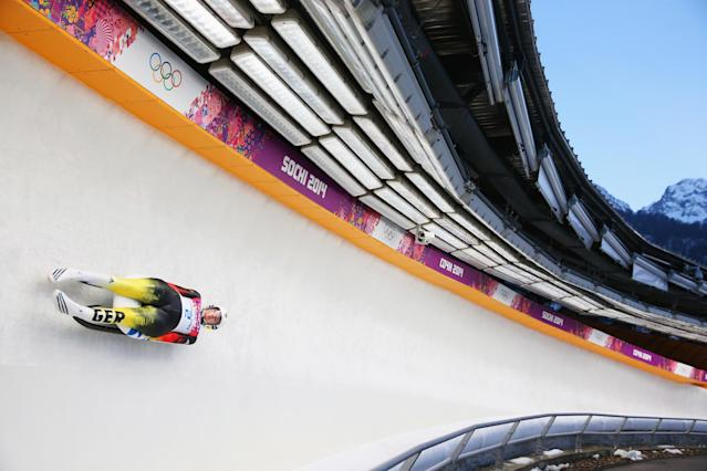 SOCHI, RUSSIA - FEBRUARY 11: Natalie Geisenberger of Germany in action during the Women's Luge Singles on Day 4 of the Sochi 2014 Winter Olympics at Sliding Center Sanki on February 11, 2014 in Sochi, Russia. (Photo by Julian Finney/Getty Images)