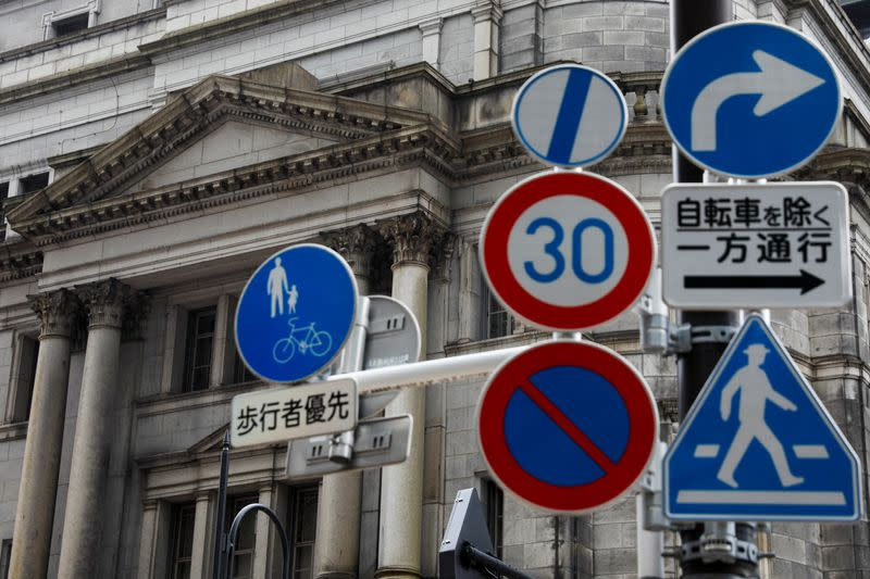 Traffic signs are seen in front of the headquarters of Bank of Japan amid the coronavirus disease (COVID-19) outbreak in Tokyo