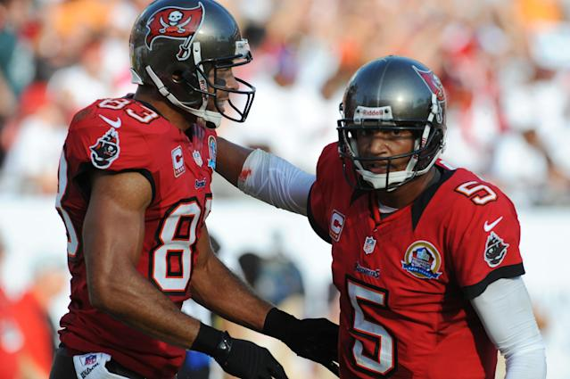 TAMPA, FL - DECEMBER 9: Wide receiver Vincent Jackson #83 of the Tampa Bay Buccaneers celebrates with quarterback Josh Freeman #5 after a touchdown against the Philadelphia Eagles December 9, 2012 at Raymond James Stadium in Tampa, Florida. The Eagles won 23 - 21. (Photo by Al Messerschmidt/Getty Images)
