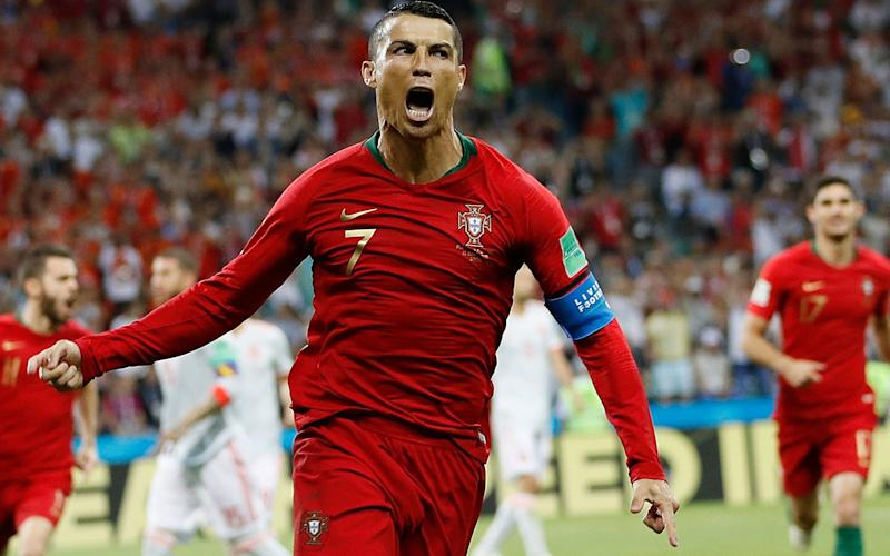 Cristiano Ronaldo's phenomenal hat-trick secured a 3-3 draw against Spain - AP