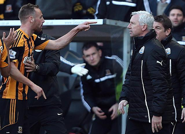 Newcastle United's manager Alan Pardew, right, and Hull City's David Meyler, left, confront each other during the during the English Premier League match at the KC Stadium, Hull England Saturday March 1, 2014. (AP Photo/Lynne Cameron/PA)