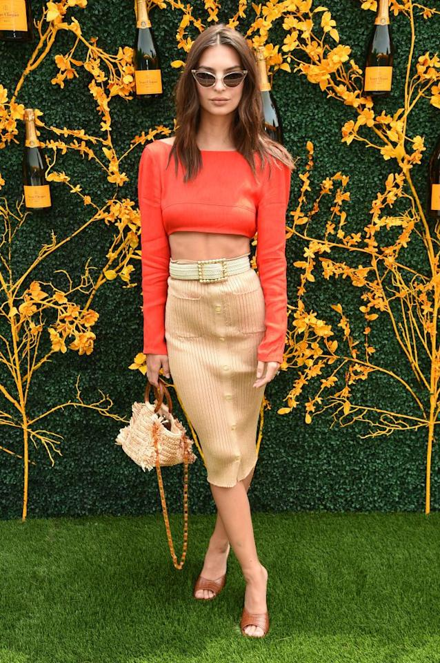 <p>Wearing a red crop top with a pencil skirt.</p>