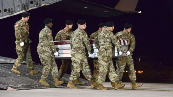 PHOTO: A U.S. Army carry team transfers the remains of Army Staff Sgt. Dustin Wright of Lyons, Ga., Oct. 5, 2017, upon arrival at Dover Air Force Base, Del. (Staff Sgt. Aaron J. Jenne/AP)