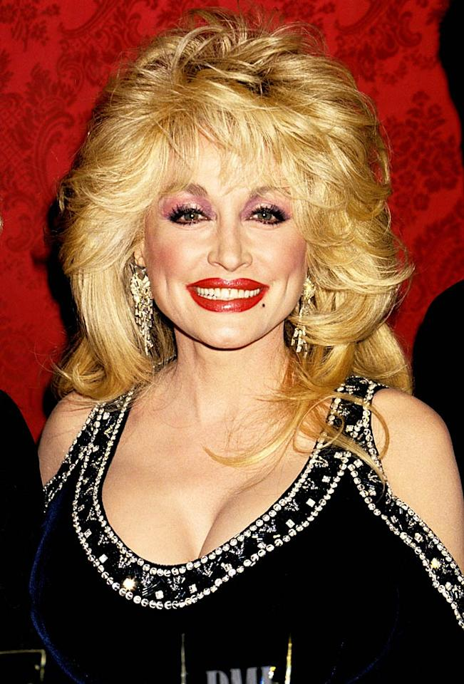 "<b>1994:</b> ""I've always loved makeup, and it's something I understand,"" Parton told <i>People</i> of her signature makeup line. ""You can do it in good taste, but if you want to look like the town tramp like me, you can.""   <a href=""http://www.instyle.com/instyle/package/transformations/photos/0,,20290120_1179632_1044596,00.html?xid=omg-aguilera-trans?yahoo=yes"" target=""new"">Christina Aguilera Through the Years</a> Jim Smeal/<a href=""http://www.wireimage.com"" target=""new"">WireImage.com</a> - May 26, 1994"