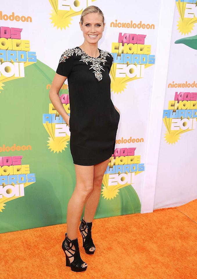 "Speaking of chic, check out the embellished Gucci mini, Jimmy Choo wedges, and sleek 'do ""Project Runway"" hostess with the mostest Heidi Klum rocked upon arriving at Nickelodeon's 24th Annual Kids' Choice Awards. Steve Granitz/<a href=""http://www.wireimage.com"" target=""new"">WireImage.com</a> - April 2, 2011"