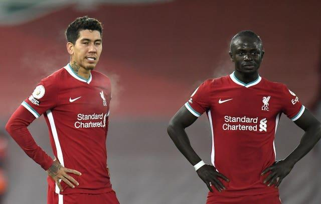 Roberto Firmino and Sadio Mane stand with their hands on their hips