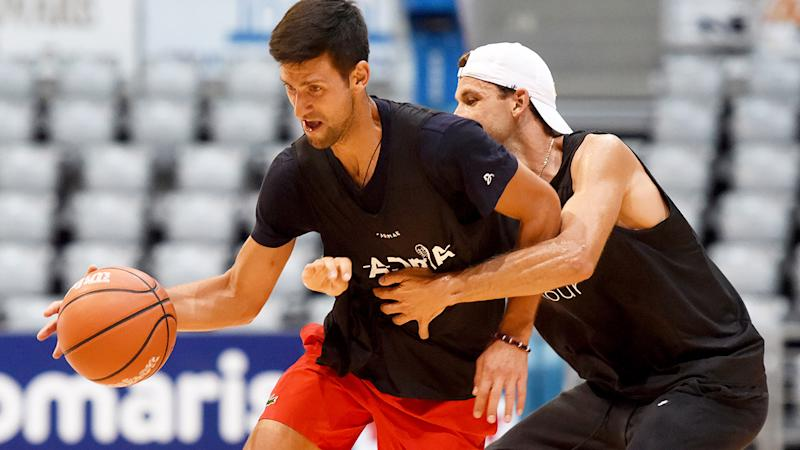 Novak Djokovic and Grigor Dimitrov, pictured here playing basketball.