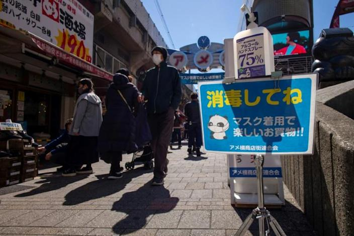 A hand sanitiser dispenser is installed on a street in Ueno shopping district of Tokyo. When the Games were postponed last year, organisers had hoped the pandemic would be receding by spring 2021