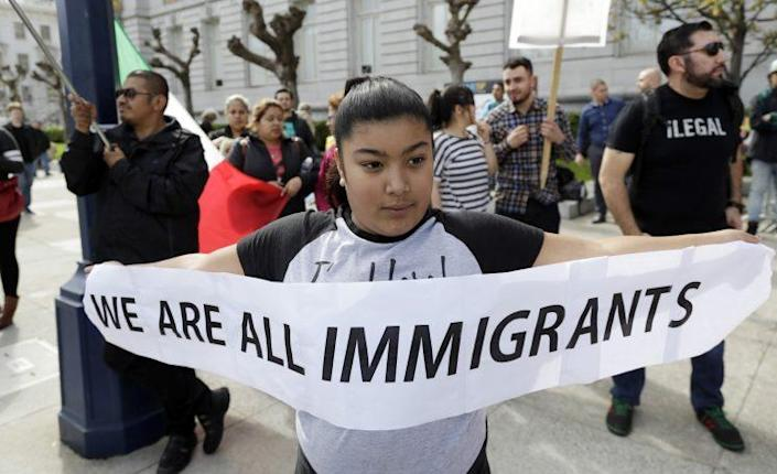 Delilah Gutierrez, 10, left, holds a sign during a protest against President Trump's efforts to crack down on immigration on Feb. 16, 2017, in San Francisco. ( Photo: Marcio Jose Sanchez/AP)